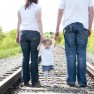 Couple stands on train tracks