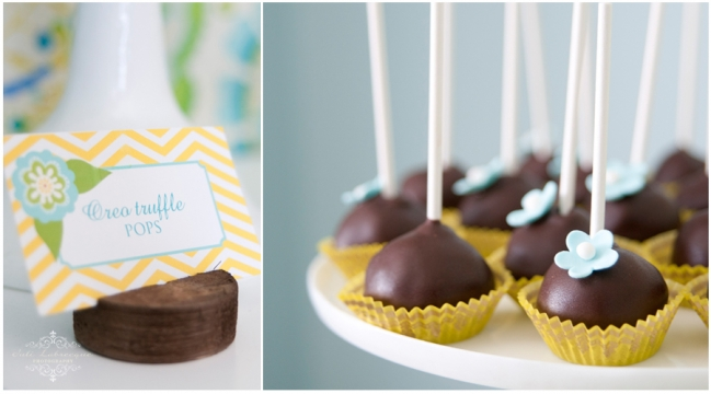 Chocolate covered Oreo Cake Pops with blue flower