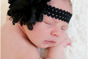 newborn with black headband